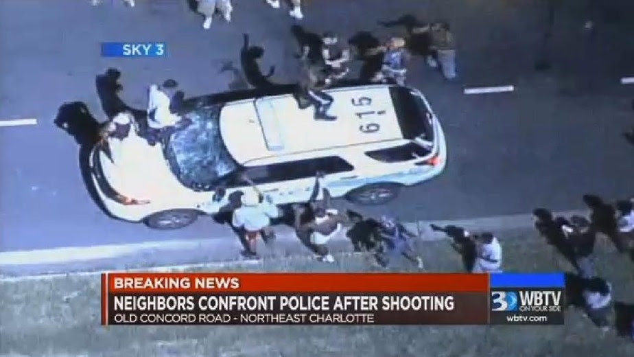 Image result for Charlotte police: Warned suspect to drop gun before shooting which triggered riots, hurt 16 officers
