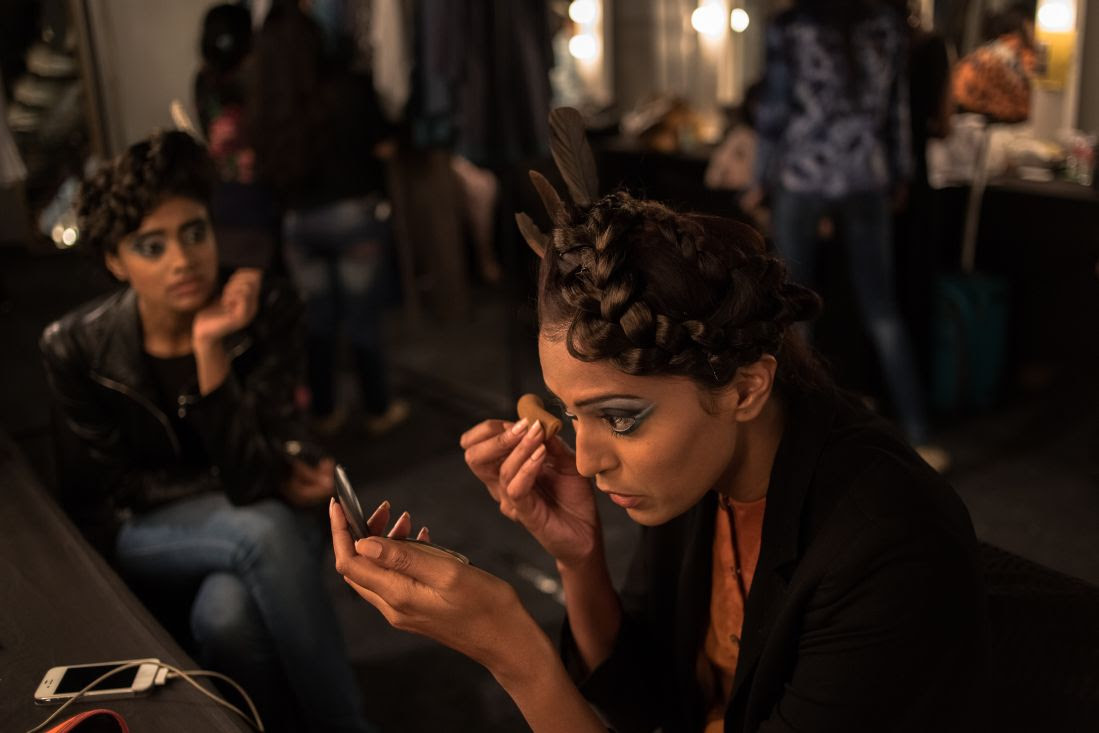 A model applies makeup backstage during the Wills Lifestyle India Fashion Week