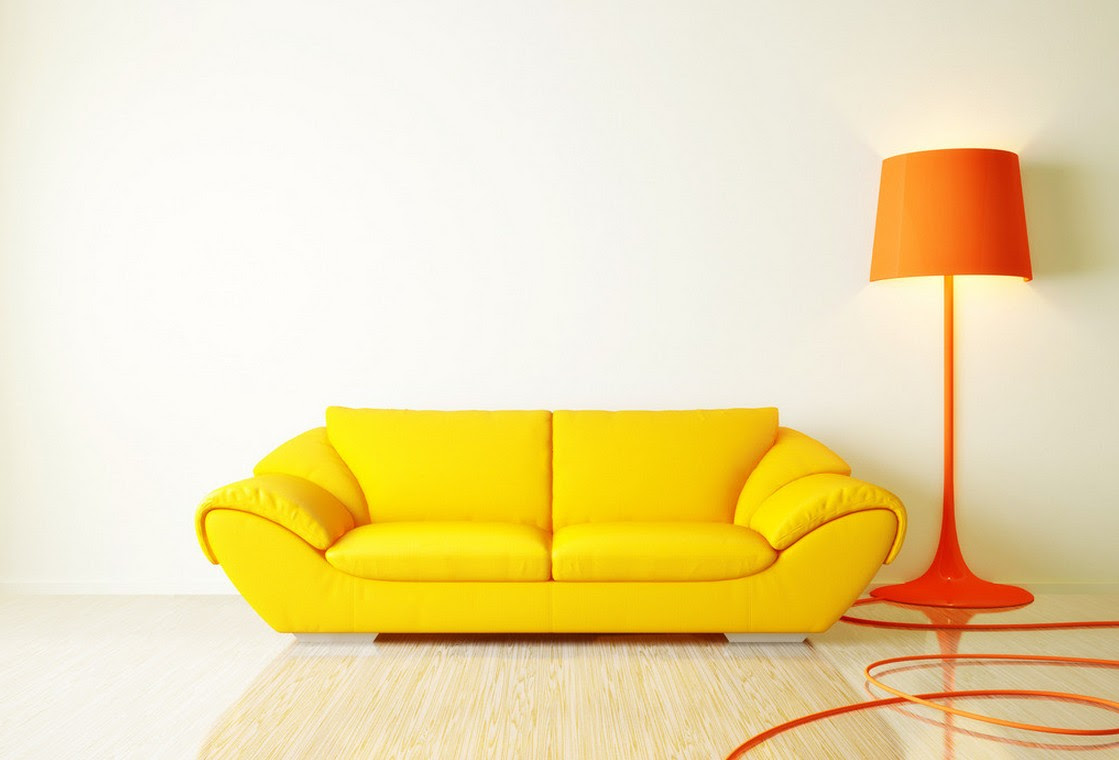 Vibrant yellow sofa and an orange lamp draw attention