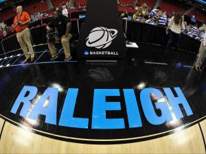 A view of the Raleigh and NCAA Basketball logos prior to a game between the Mercer Bears and the Duke Blue Devils during the second round of the 2014 NCAA Men's Basketball Tournament at PNC Arena on March 21, 2014 in Raleigh, NC. (Lance King/WRAL contributor)