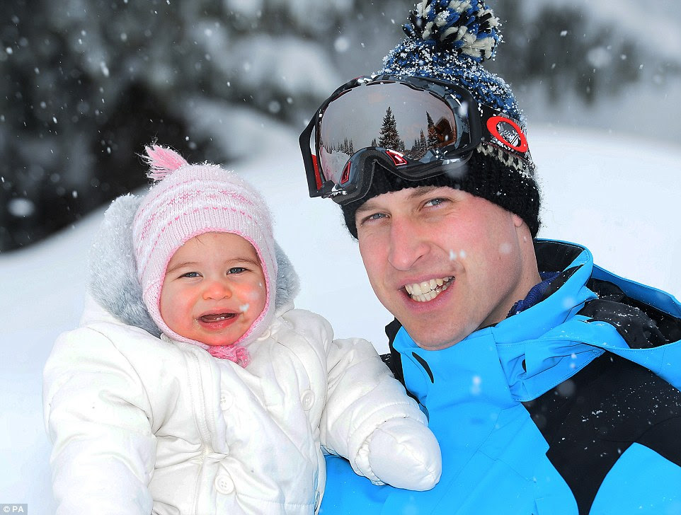 'Workshy': Prince William, seen holding his ten-month-old daughter to the camera, has previously faced criticism over his work-life balance