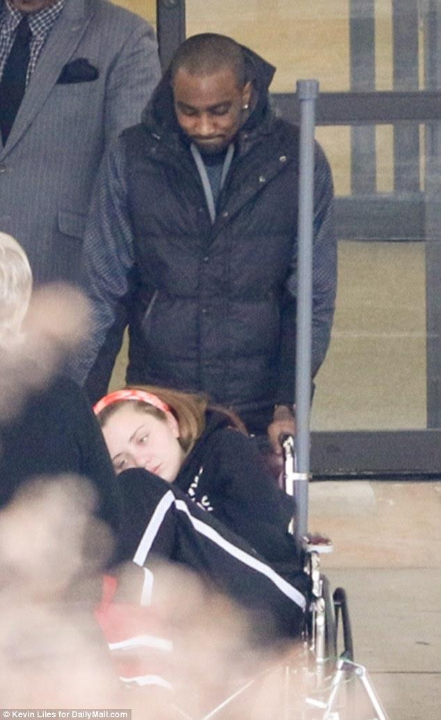 A smirking Nick Gordon is seen pushing Bobbi Kristina's friend Danyela Bradley out of North Fulton Hospital in Atlanta. It is the same hospital where Bobbi Kristina was taken after she was found face down in her bathtub