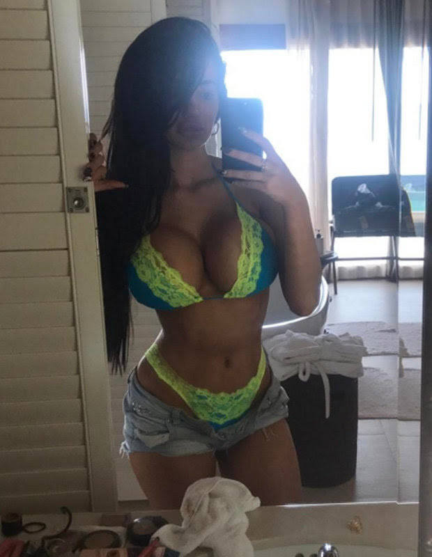 Chloe Khan in a plunging swimsuit