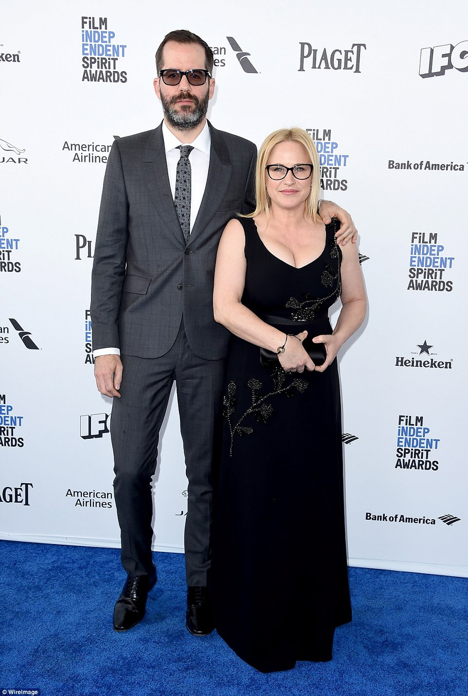 They are going strong: Patricia Arquette (R) posed with beau Eric Whiteas both wore black