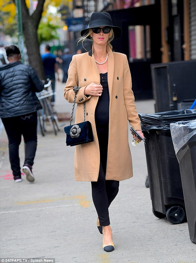Bump in the city: The pregnant socialite, 34, displayed her baby bump in a tight black tank top and matching skinny jeans as she enjoyed a spot of shopping