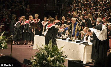 Masters students graduate at the Royal Albert Hall in London. The educational disadvantage lingers through to A-levels and beyond, a report has found
