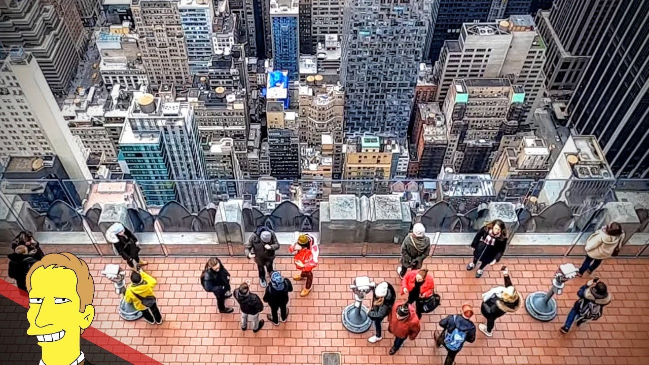 view from top of Rockafeller Center down to lower observation deck and New York City