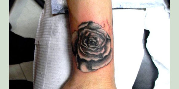 Black Rose Tattoo On Left Arm