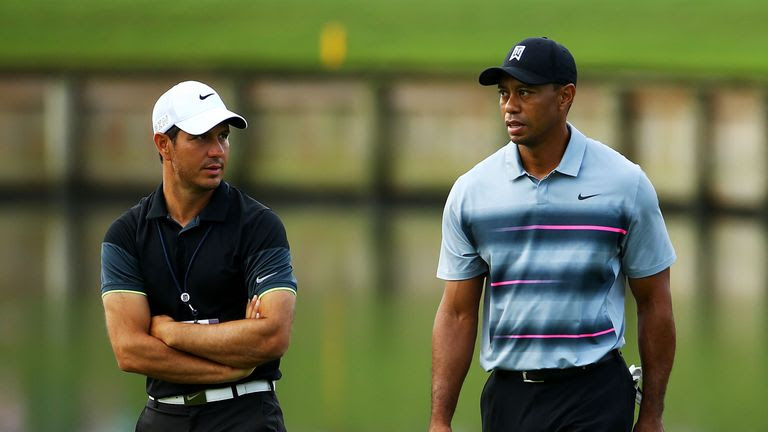 Tiger Woods (right) says he has nothing but respect for Chris Como (left)