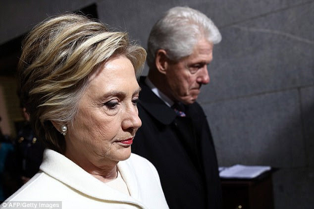 http://i.dailymail.co.uk/i/pix/2017/10/15/17/455D939900000578-4982540-Clinton_seen_with_Bill_at_the_inauguration_also_evaded_criticism-a-32_1508083970747.jpg