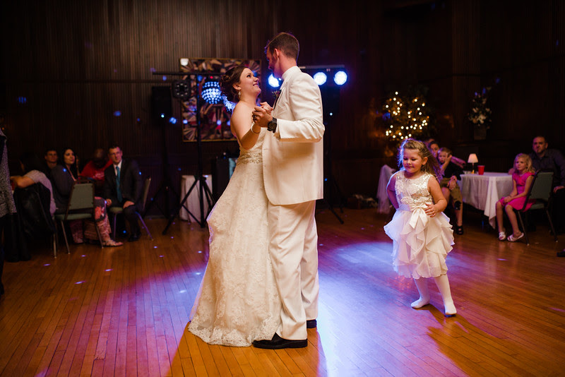 The bride and groom hang out and dance and hang fun with their family and friends at their wedding reception at Rockford Women's club in downtown Rockford IL.