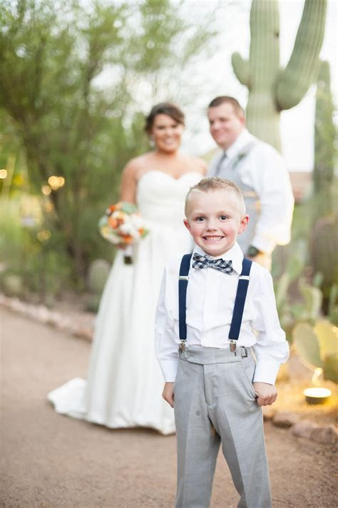 Ring bearer outfit, gray slacks, navy suspenders, blue