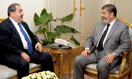 Egyptian President Mohamed Morsi with Iraqi Foreign Affairs Minister Hoshyar Zebari. Iraq declined an offer to deposit $4 billion in Egypt as too risky. by Pan-African News Wire File Photos