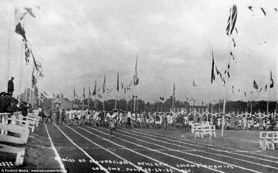 The Allies are pictured competing against each other in an athletics meeting in Coblenz. The story of the Brits time in Germany after the first world war has been told in a new book'The British Army of the Rhine after the First World War' by Michael Foley