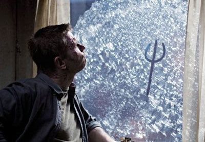 Lucifer kills time by drawing on a window in SUPERNATURAL.