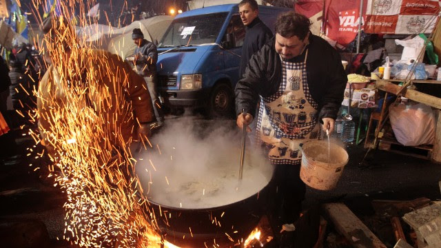 Protesters prepare food at a camp at central Independence Square on December 7, as thousands keep their vigil in Ukraine's capital.