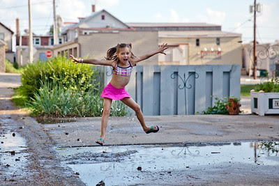 Freja Lutz can never pass an opportunity to jump in a puddle after a summer rain storm.