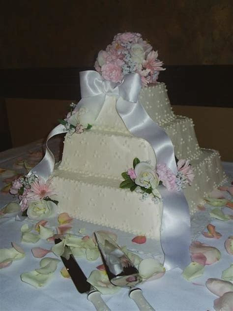 Square Wedding Cakes with pink flowers and white ribbon Hi