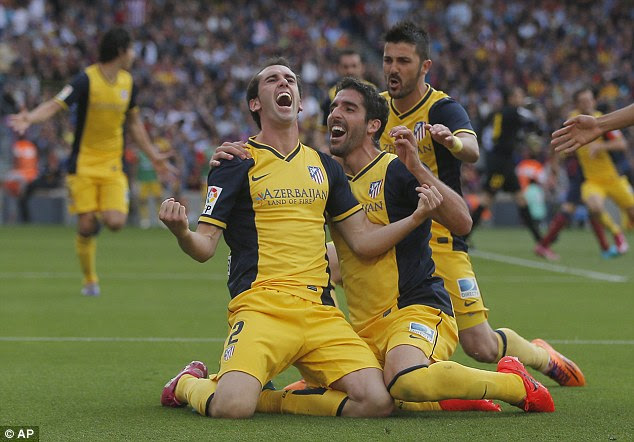 Diego Godin scored Atletico's equaliser in a thrilling game and it proved enough to win them the league