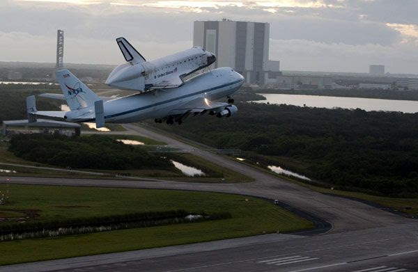 The orbiter Endeavour, mated atop NASA 905, departs from Kennedy Space Center for the final time on September 19, 2012.