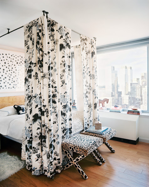 Bedroom - A floral bed canopy and a pair of leopard-print benches