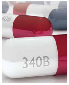 "Pill capsule with the words ""340b"" on it"