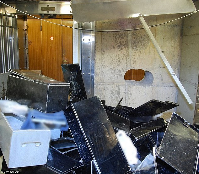 Discarded: This image shows how thieves had strewn safety deposit boxes across the basement floor when police arrived. It has now been suggested hundreds of gold bars and jewels may have been left behind too