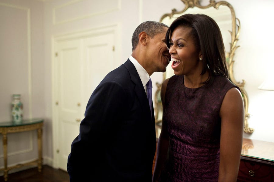 Barack whispers something to Michelle during a break between events at the 2011 UN General Assembly.