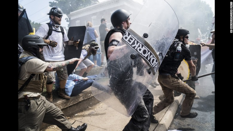 Right-wing rally members clash with counterprotesters in Emancipation Park, where white nationalist groups gathered for a rally.