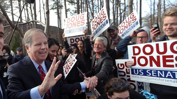 Democratic candidate Doug Jones greets supporters after casting his ballot Tuesday, Dec. 12, 2017, in Mountain Brook , Ala.   Jones is facing Republican Roy Moore. (AP Photo/John Bazemore)