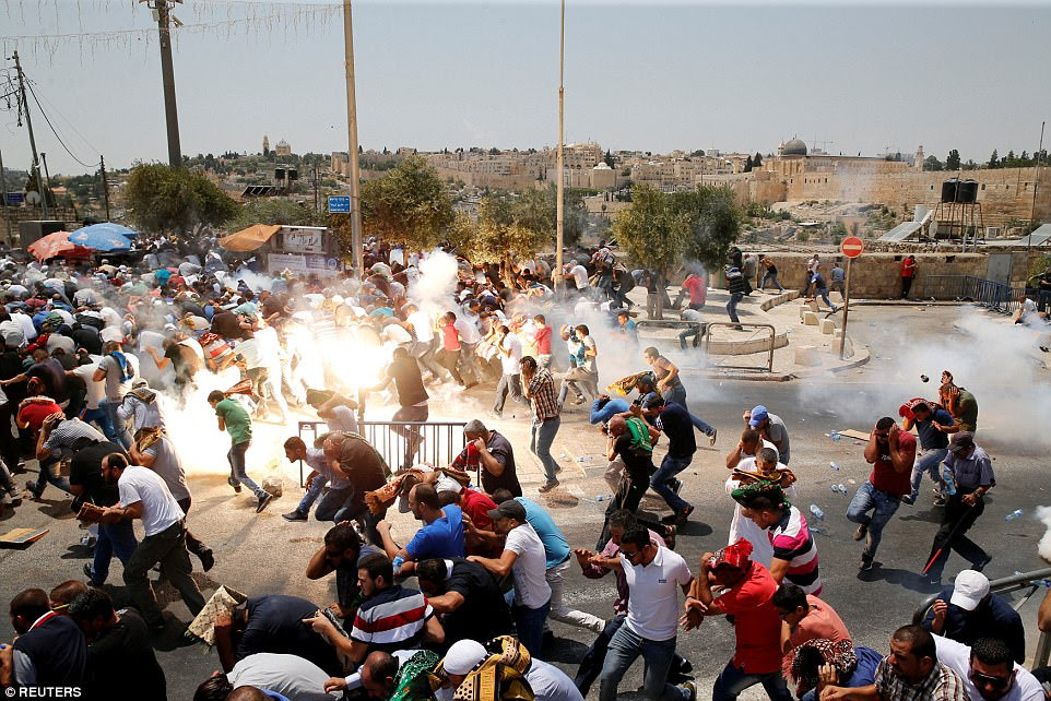 Israeli forces fire tear gas at Palestinians following Friday prayers at Wadi al-Jozin East Jerusalem on July 21. Three Palestinians were killed in clashes over the highly sensitive worship site and three Israelis were stabbed to death in the West Bank