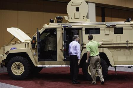 Attendees look at the Lenco MRAP Bear SWAT Team vehicle at 7th annual Border Security Expo in Phoenix