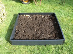 A layer of compost from one of the bins