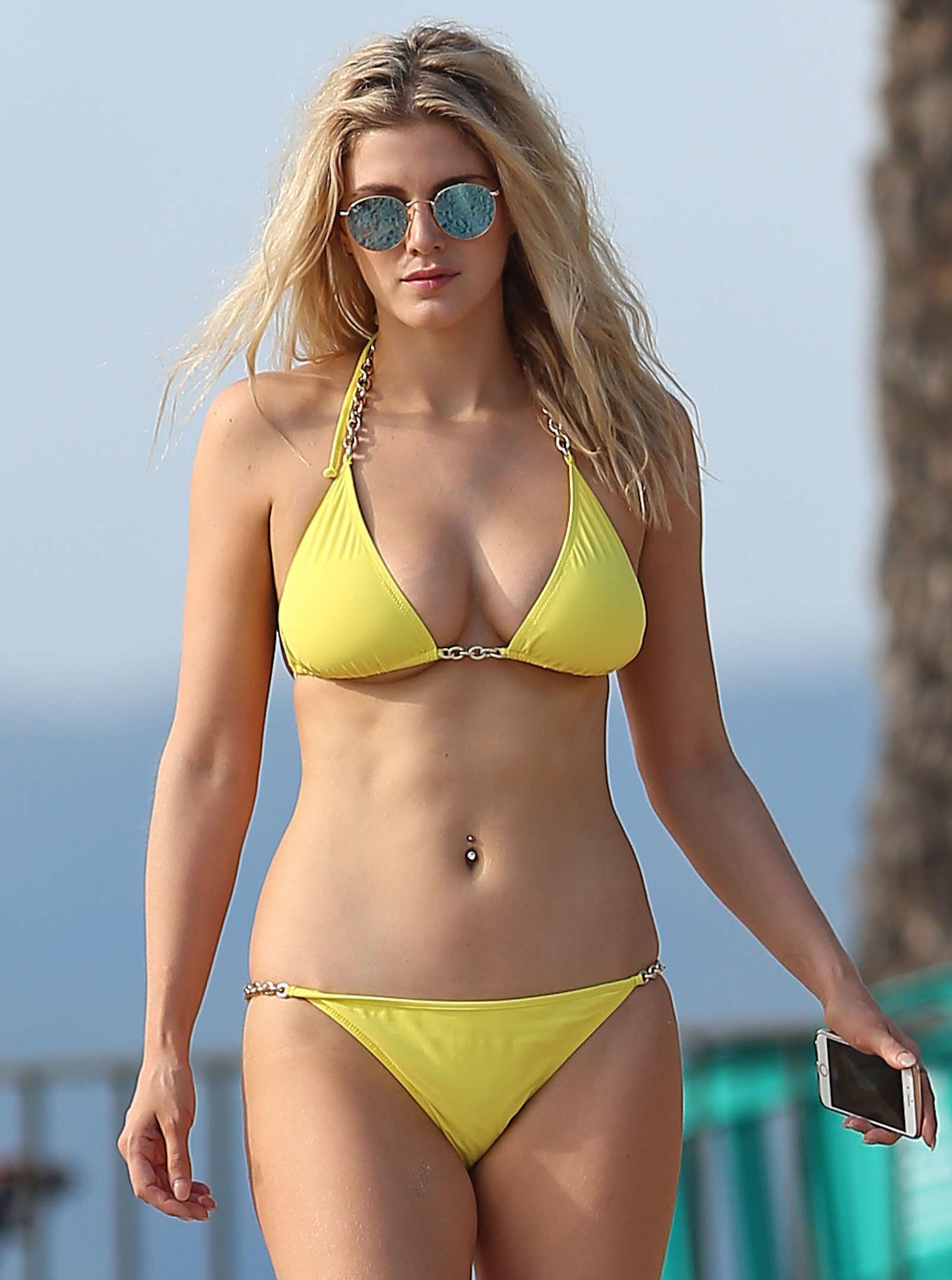 Ashley James in Yellow Bikini on the beach in Ibiza
