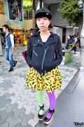Harajuku Girl in Batman Skirt, Purple-Green Tights & Rocking Horse Shoes