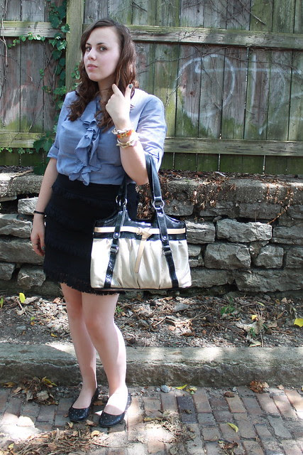 Black and chambray outfit: ruffled chambray shirt, fringe and eyelet skirt, quilted flats, etc.