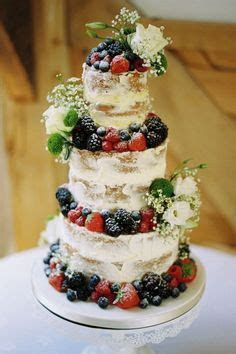 Beautiful naked wedding cake with fresh berries  what a