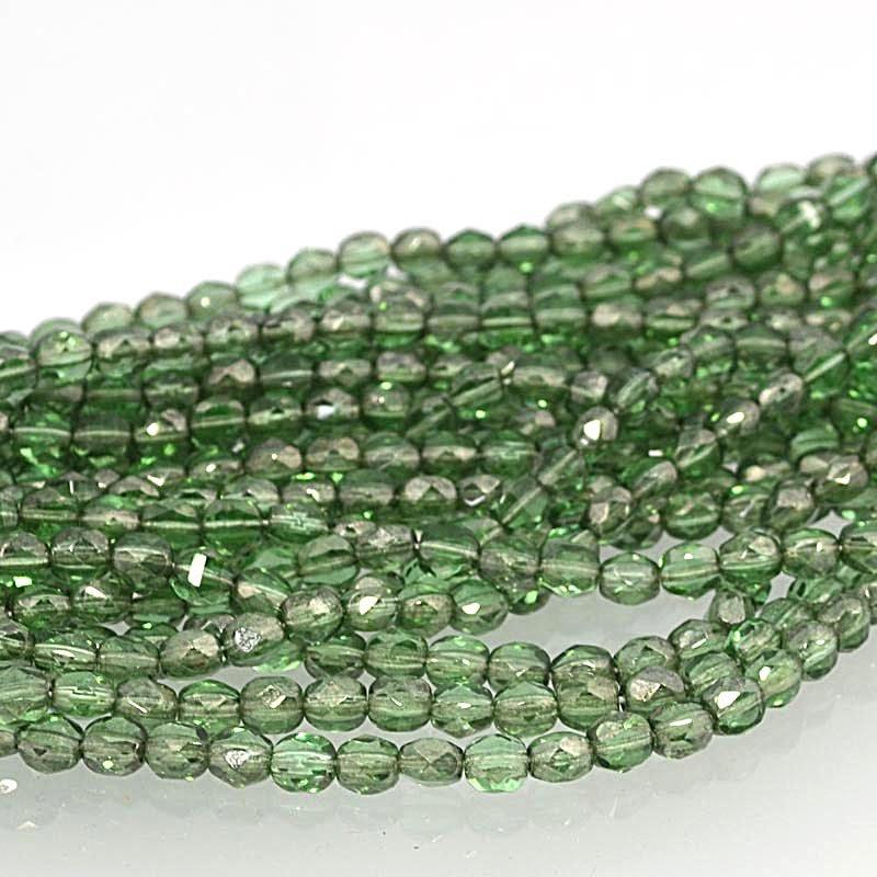 s37771 Firepolish - 6 mm TwoWay Cut - Bottle Green Lustre (strand 25)