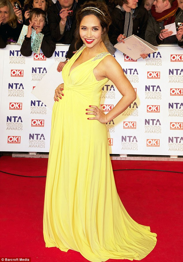 Battle of the bumps: Pregnant Myleene Klass looked stunning at the National Television Awards 2011 in a canary yellow dress and pretty headband