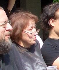 Leena Peltonen sitting beside Juhani Hinkkanen