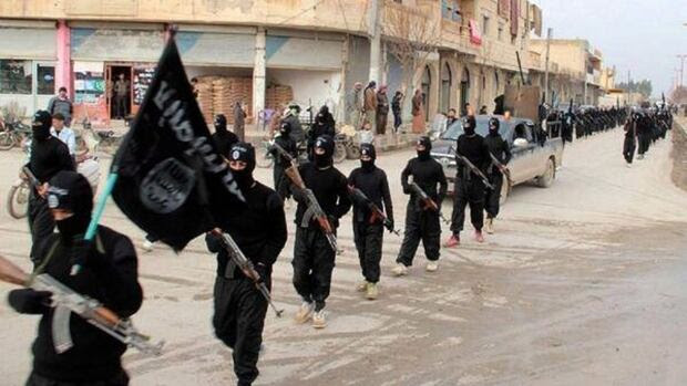 ISIS's force ranges anywhere from 10,000 to 20,000, analysts say. Here, members march carrying the group's black flags.