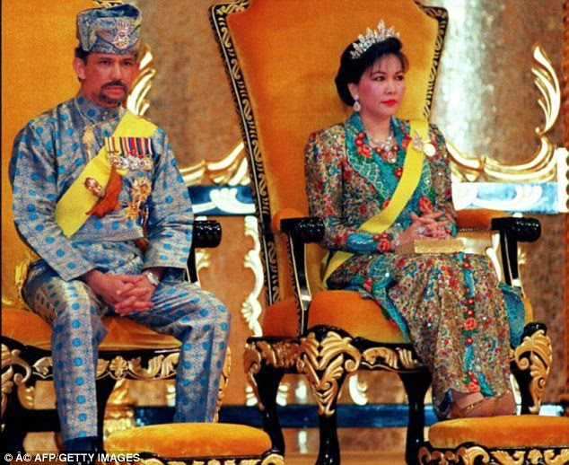Mariam Aziz with her former husband, the Sultan of Brunei. Ms Aziz's bodyguard Lim is accused of stealing gems valued at £12m, replacing them with near-worthless replicas