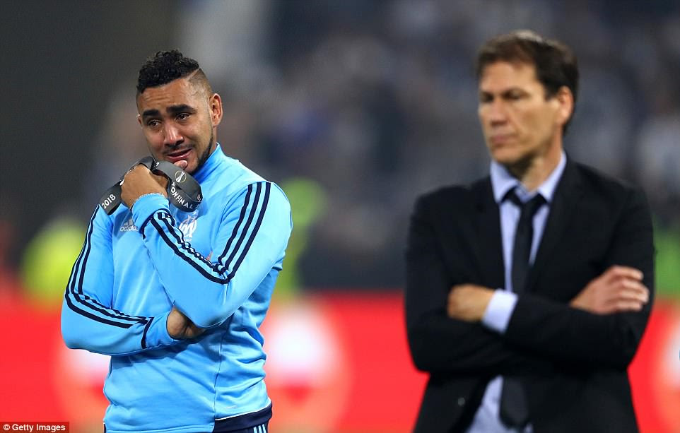 Dimitri Payet is left in tears as he watches Atletico Madrid lift the trophy he could have won with his beloved club Marseille