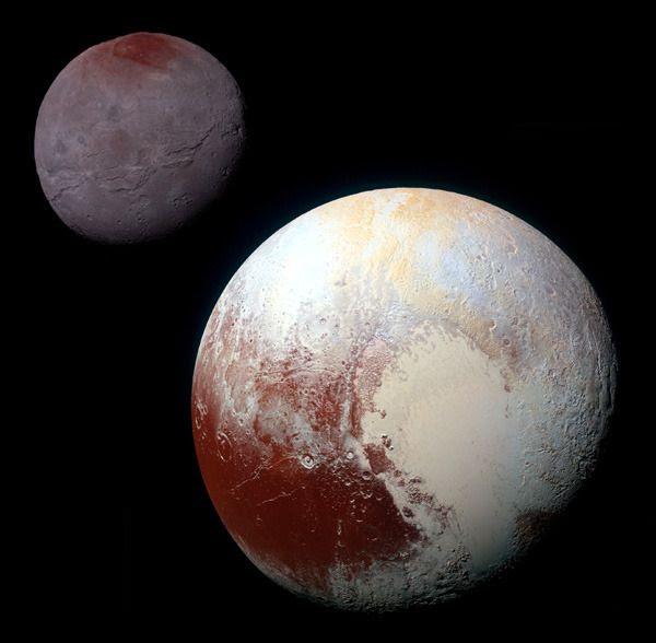 A high-resolution, enhanced-color composite image of Pluto and Charon that was taken by NASA's New Horizons spacecraft on July 14, 2015.
