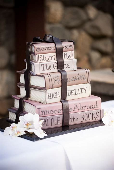 Picture Of blush stacked books wedding cake