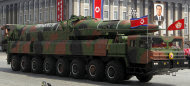 In this photo taken Sunday, April 15, 2012, what appears to be a new missile is carried during a mass military parade at the Kim Il Sung Square in Pyongyang, North Korea, to celebrate the 100th anniversary of the country's founding father Kim Il Sung. The photo of the missile shows the warhead's surface is undulated, suggesting it's a thin metal sheet unable to withstand flight pressure, analysts say. Adding more doubt to North Korea's claims of military prowess after its flamboyant rocket launch failure, analysts say the half dozen missiles showcased at the military parade were low-quality fakes. (AP Photo/Ng Han Guan)
