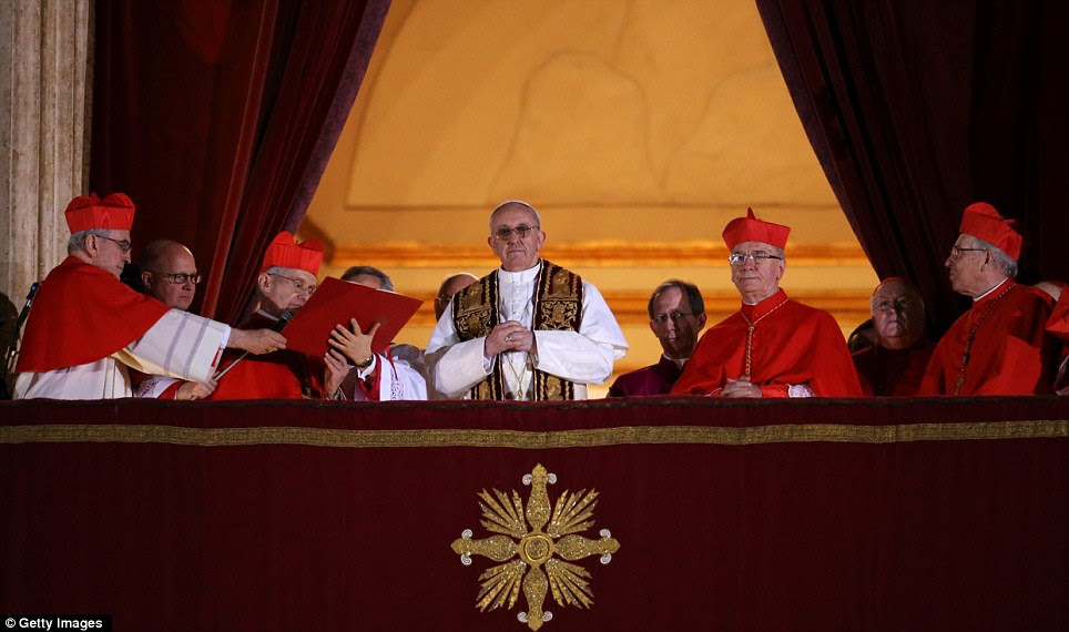 Looking out: Newly elected Pope Francis I appeared on the central balcony of St Peter's Basilica in the Vatican City before tens of thousands of excited Catholics
