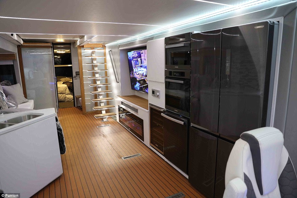 The interior of the stunning RV (pictured) is better-equipped than most people's apartments