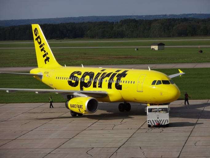 Spirit's first aircraft to get the airline's new paint scheme is rolled outside for photographs  at the Premier Aviation Overhaul Center in Rome, N.Y., on Sept. 15, 2014.