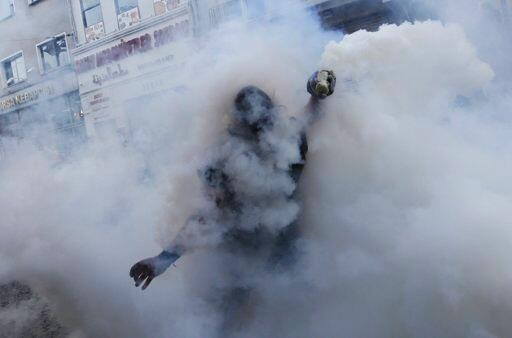 A protester in the midst of tear gas hell in Taksim